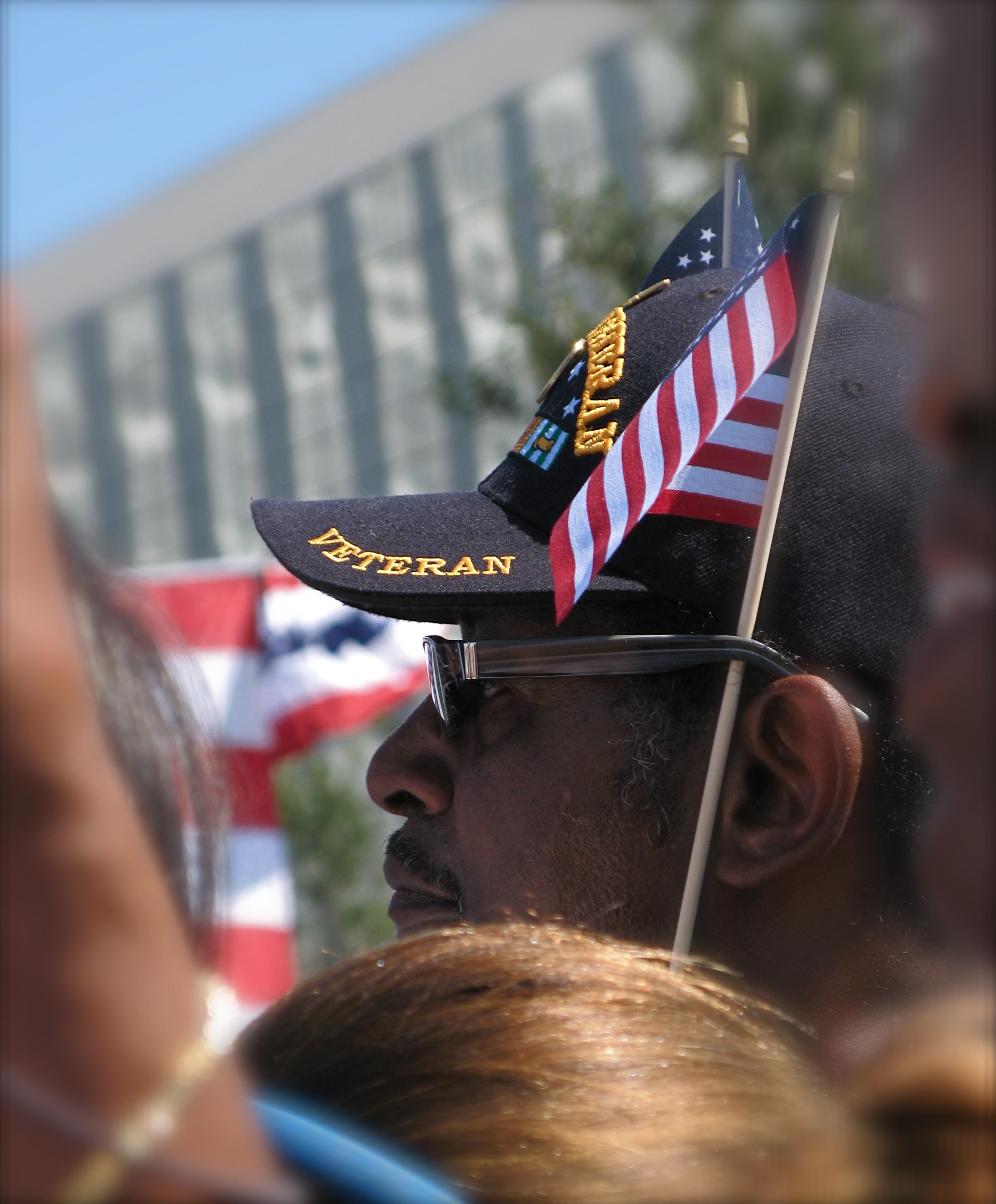 veteran in cap with flag