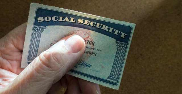 social security card with thumb