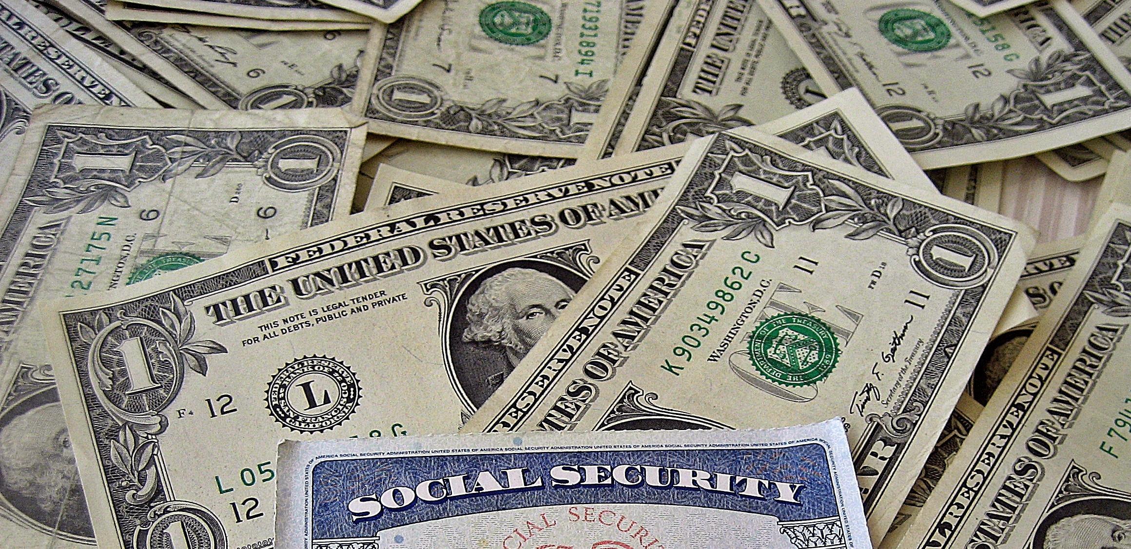 social security card on dollar bills