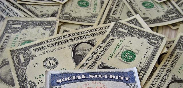 social security card on dollar bills